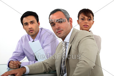 Team Of Business Professionals Having A Meeting Stock Photo