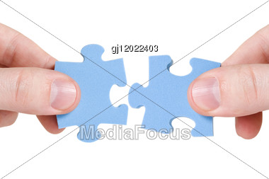 Teamwork Concept. Two Hands With Different Pieces Of Puzzle Stock Photo