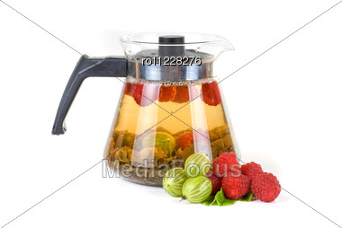 Teapot With Fruit Tea And Berries Stock Photo