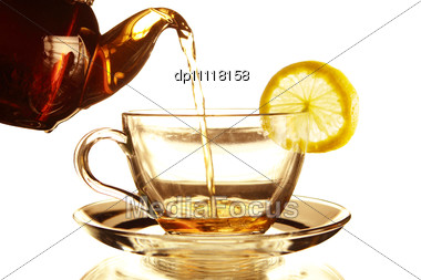 Teapot And Glass Cup Of Tea With Lemon Stock Photo