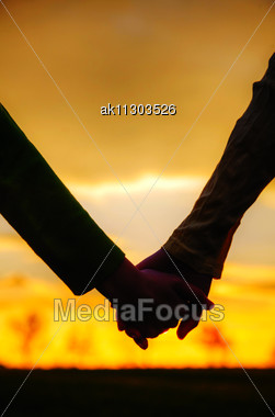 Teen Girls Holding Hands At Sunset Time Stock Photo