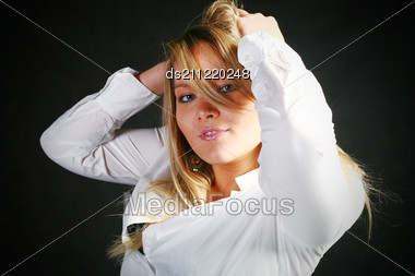Teenage Blond Girl Portrait, Studio Shot On Dark Stock Photo