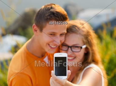 Teenage Couple Taking A Selfie At A Trip To The Seaside Stock Photo