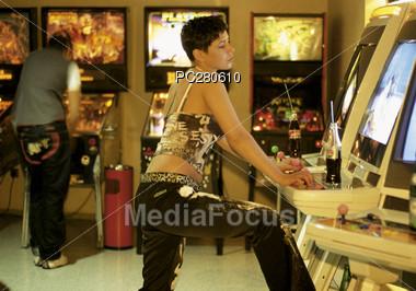 Teenage Girl Playing Arcade Videogame Stock Photo