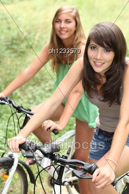 Teenage Girls Riding Their Bikes Stock Photo