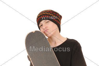 Teenager With A Skateboard And In A Hat Stock Photo