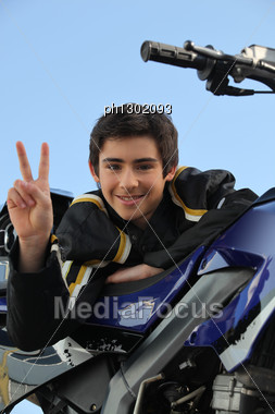 Teenager Stood By His Motorcycle Stock Photo
