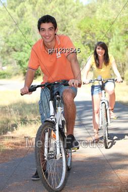 Teenagers Cycling Stock Photo