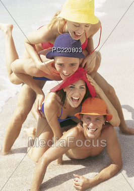 Teenagers Having Fun on the Beach Stock Photo