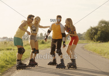 Teenagers Inline-skating Stock Photo
