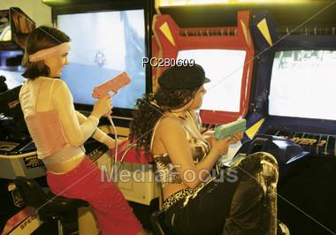 Teenagers Playing Shooting Videogames Stock Photo