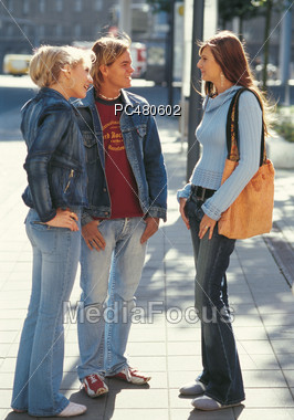 Teenagers Talking Standing on Sidewalk Stock Photo
