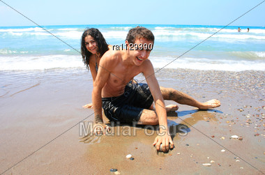 Teens On The Beach,having Fun Stock Photo