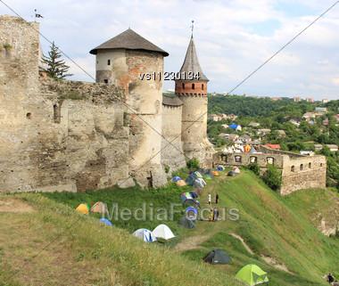 Tents Under Ancient Castle Walls Stock Photo