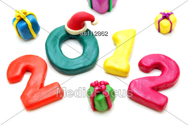 Text 2012 With Multi Gifts In Random Isotated On White Stock Photo