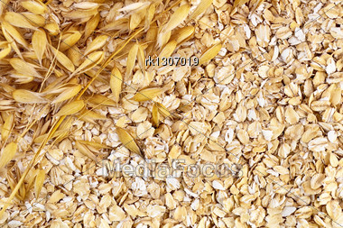 Texture Of Oatmeal With Stalks Of Oats In The Upper Left Corner Stock Photo
