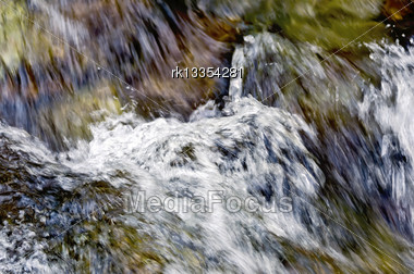 Texture Of The Raging Stream Of Water In The Waterfall Stock Photo