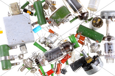 Texture Of Various Old, Vintage Radio Components. Isolated Stock Photo