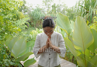 Thai Woman In Greeting Posture Stock Photo