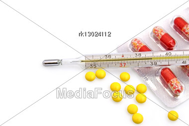 Thermometer With The Yellow Pills In Bulk And Red-white Capsules In A Package Stock Photo