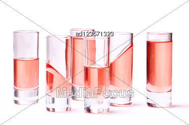 Thin Glasses With Pink Liquid Stock Photo