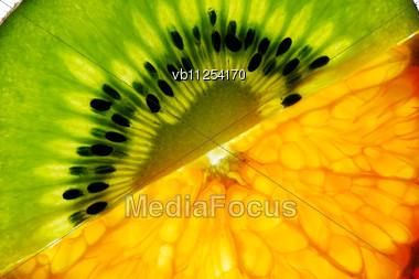 Thin Slices Of Kiwi And Mandarin Stock Photo