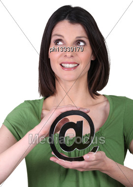 Thirty-ish Brunette Looking Up Holding At Sign Stock Photo