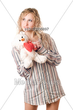 Thoughtful Blonde Holding Teddy Bear. Stock Photo