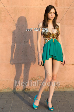Thoughtful Leggy Woman Posing In Frank Dress Outdoors Stock Photo