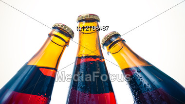 Three Amber Bottles With Beer Stock Photo