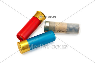Three Ammunitions For A Rifle, Red, Blue And White Stock Photo