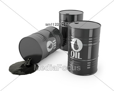 Three Barrels And Spilled Oil Stock Photo