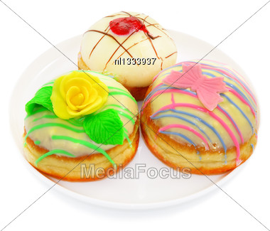 Three Beautiful Donut With White Chocolate. Decorated With A Rose And A Butterfly Stock Photo