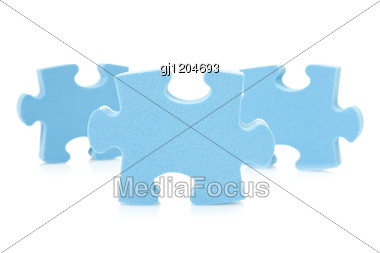 Three Blue Puzzle Pieces Stock Photo