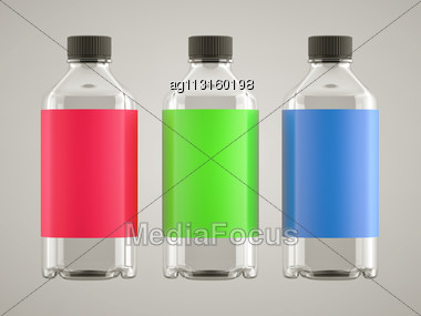 Three Bottles For Chemicals Or Fluids With Colorful Stickers Over Grey Background Stock Photo