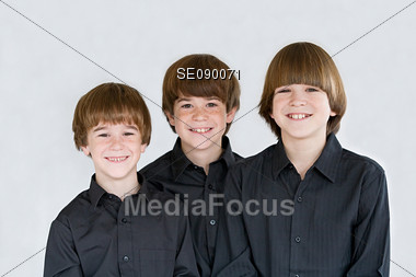 Three Brothers Dressed in Black Stock Photo