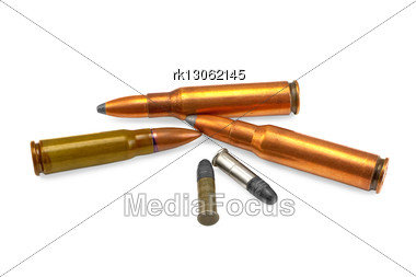 Three Bullets For The Automatic Weapons And Two For Small-bore Rifle Isolated Stock Photo