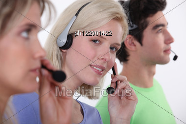 Three Call-center Workers Stock Photo