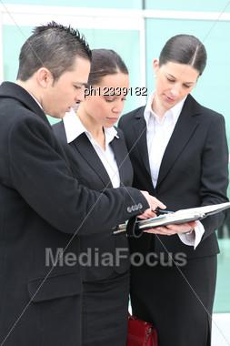 Three Colleagues Debating Stock Photo