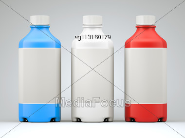 Three Colorful Bottles For Chemicals Or Drugs Over Grey Studio Background Stock Photo