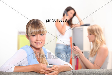 Three Female Housemates Stock Photo