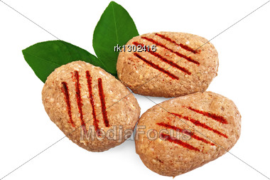 Three Frozen Meat Patties, Two Green Leaf Lemon Isolated Stock Photo