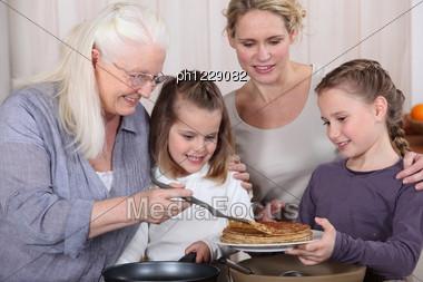 Three Generations Enjoying Crepes Stock Photo