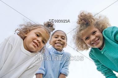 Three Girls Smiling Stock Photo