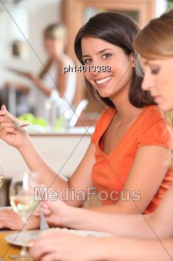 Three Housemates, Eating Together Stock Photo