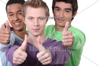 Three Male Friends Giving Thumb's Up Stock Photo