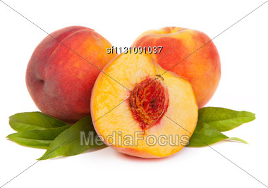 Three Perfect, Ripe Peaches With A Half Isolated On A White Background Stock Photo