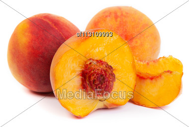 Three Perfect, Ripe Peaches Isolated On A White Background Stock Photo
