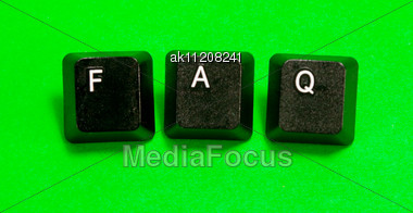 Three Plastic Keys With FAQ Word Over Green Background Stock Photo
