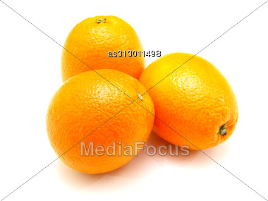 Three Ripe Oranges Lie Nearby Stock Photo